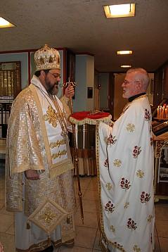 Parish Priest, Father Sam presents the Hand Cross