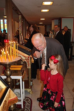 St. Michael's parishioner and granddaughter lighting candles